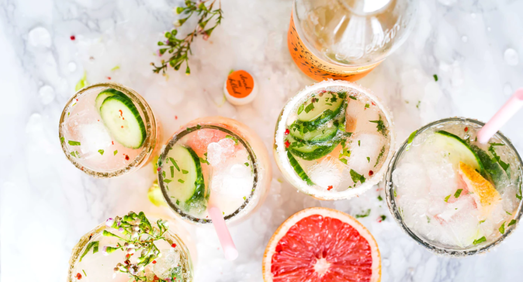 several grapefruit and cbd infused cocktails on the counter