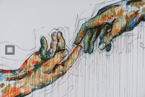 Mural of hands reaching for each other